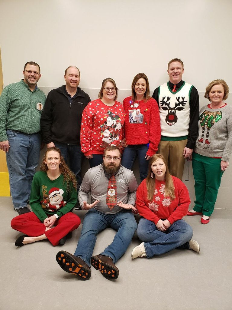 Teacher's show off their holiday spirit by wearing their ugly sweaters to work